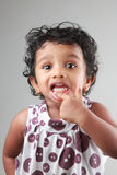 Little girl shows her teeth Stock Photo