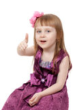 A little girl shows OK Stock Photo