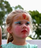 Face-painted girl in another world. royalty free stock image