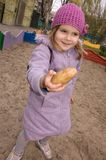 Little girl shows a potato Stock Photography