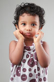 Little girl shows some actions Stock Image