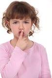 Little girl shushing Stock Image
