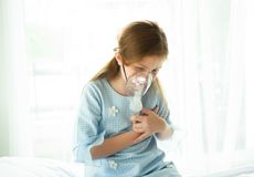 Little girl is sick, using inhaler and heart ache in hospital wa stock photos
