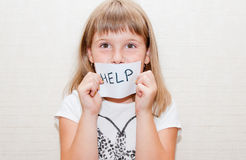 Little girl with sign help. Little girl shows sign card with help message Stock Images