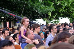 Little girl siiting on fathers shoulders on the Francofolies festival in Blagoevgrad, Bulgaria. 18.06.2016 Royalty Free Stock Image