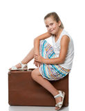 Little girl siiting on the suitcase Royalty Free Stock Photos
