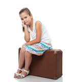 Little girl siiting on the suitcase Stock Images