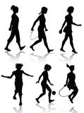 Little girl silhouettes playing Royalty Free Stock Image