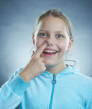 Little girl with silly face. Stock Photos