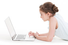 Little girl with silver color laptop. Stock Image