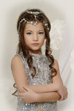 Little girl in a silver dress Royalty Free Stock Photography