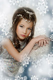 Little girl in a silver dress Stock Photography