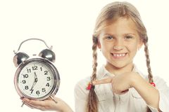 Little girl with a silvered alarm- Royalty Free Stock Photo