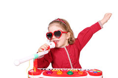 Little girl sing. And play music Royalty Free Stock Images