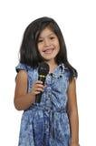 Little Girl Singer. Beautiful hispanic girl singer performing at a concert stock photos