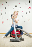 Little girl singing during cleaning the flat. Royalty Free Stock Photos