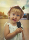Little girl is singing holding  a microphone Stock Image