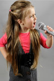 Little girl singing karaoke Royalty Free Stock Photography