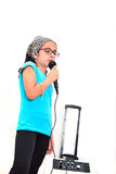 Little girl singing karaoke Royalty Free Stock Image
