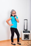 Little girl singing karaoke Royalty Free Stock Photo