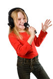Little girl singing in microphone Royalty Free Stock Photography