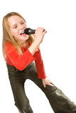 Little girl singing in microphone isolated Royalty Free Stock Image