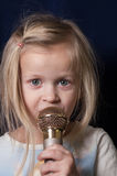Little Girl Singing Stock Photography