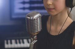 Little girl singing a song. Little girl singing a song in home recording studio Stock Photography