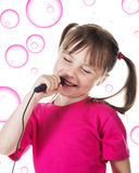 Little girl sings Royalty Free Stock Photo