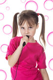 Little girl sings Royalty Free Stock Photos