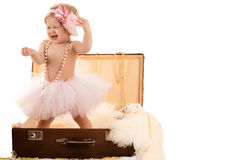 Little girl sings while standing in a suitcase Royalty Free Stock Photo