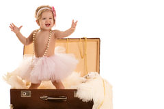 Little girl sings while standing in a suitcase Royalty Free Stock Photography