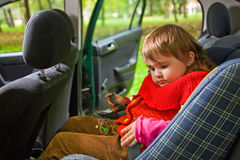 Little girl sit in car in park Royalty Free Stock Photo