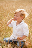 Little girl sit on her knees Stock Photography