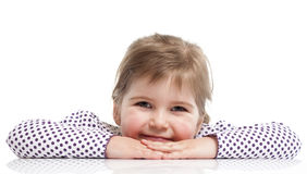 Little girl is siting. And laying on table Stock Photo