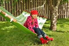 Little girl siting in hammock Stock Image