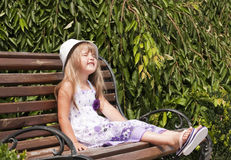 Little girl siting in the park Stock Photo