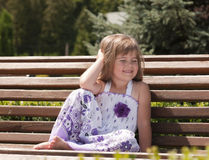 Little girl siting in the park Stock Photography