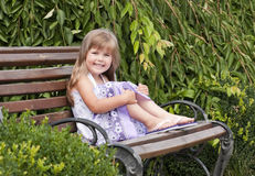 Little girl siting in the park Royalty Free Stock Photography
