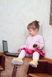 Little girl sits Stock Photography