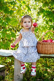 Little girl sits on a bench Royalty Free Stock Photos