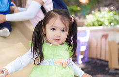 Beautiful Little Asian Girl on a slide Royalty Free Stock Image