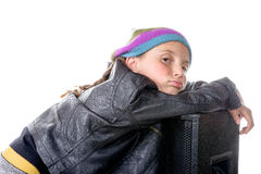 A little girl sits on a loudspeaker Royalty Free Stock Images