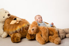 The baby and teddy Bear Stock Images