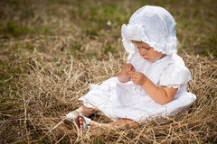 A little girl sits in the nest Royalty Free Stock Photography
