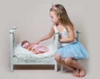 Little Girl Sits Next Her Newborn Sister Stock Images