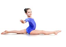 Little Girl Sits On A Splits Stock Photography