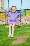 Little Girl Sits On Swing Stock Photo