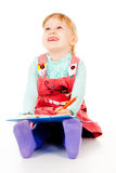 A little girl sits and paints Royalty Free Stock Photography