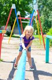 Little girl sits on a pipe Royalty Free Stock Images
